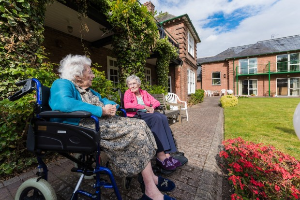 Two ladies talking in the gardens at Lamel Beeches