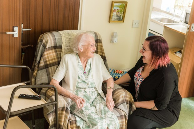 Resident and carer talking