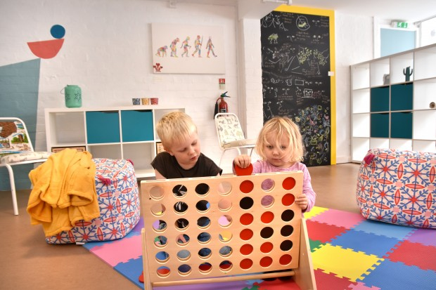 Children playing with the toys in the new Folk Hall Discovery Room