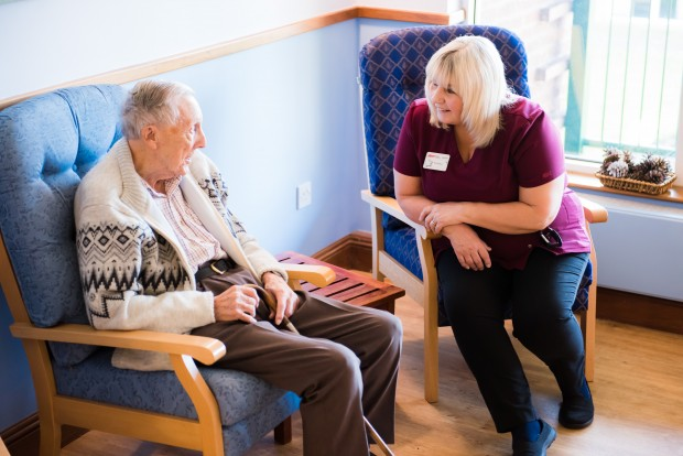 A member of care team spending time wiith an resident at Lamel Beeches