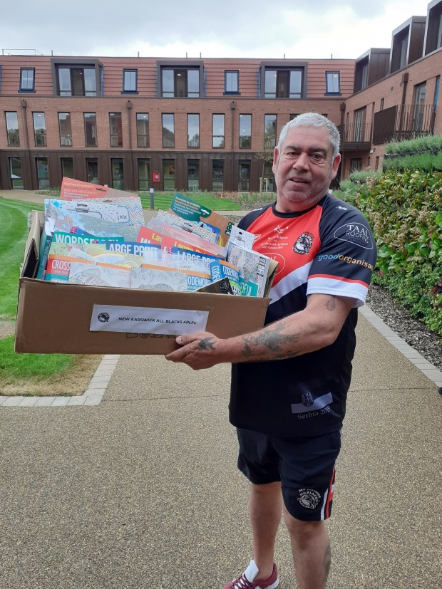 New Earswick All Blacks Rugby Player making Donations