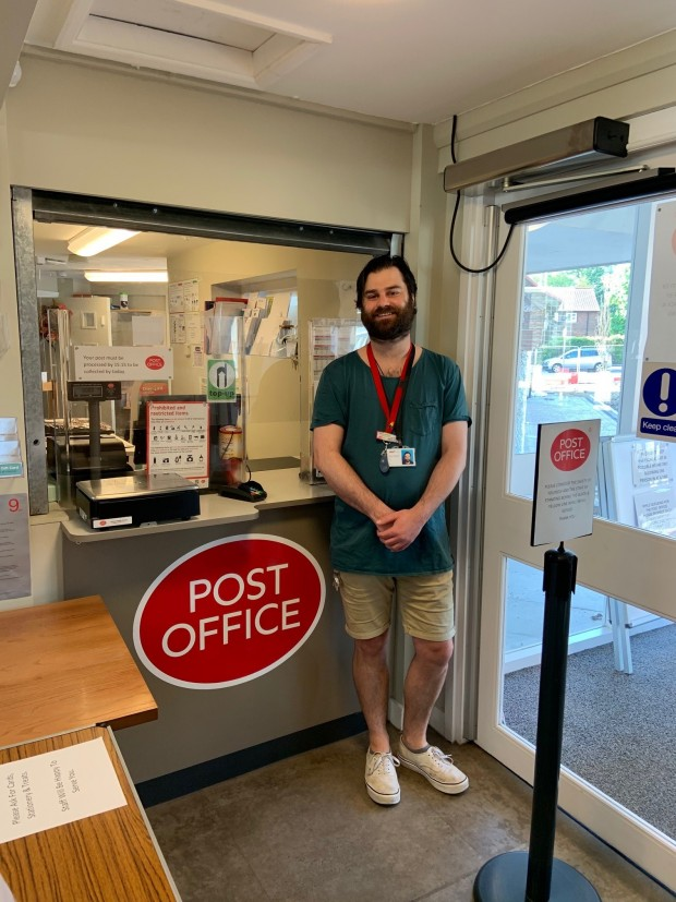 Staff Member working at the post office in New Earswick Folk Hall