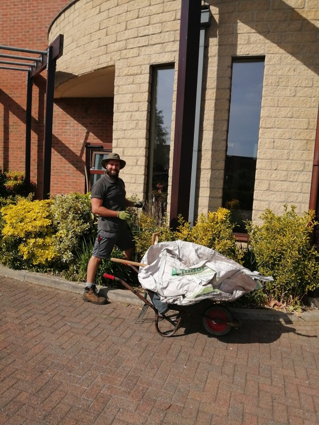 Staff member Simon looking after the gardens at Plaxton Court