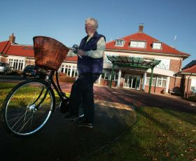 Elderly woman going on a bike ride at Hartrigg Oak