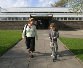 Parent and child outside New Earswick swimming pool