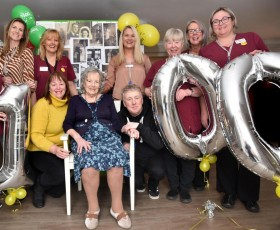 Lily celebrating her 100th birthday with staff at New Lodge