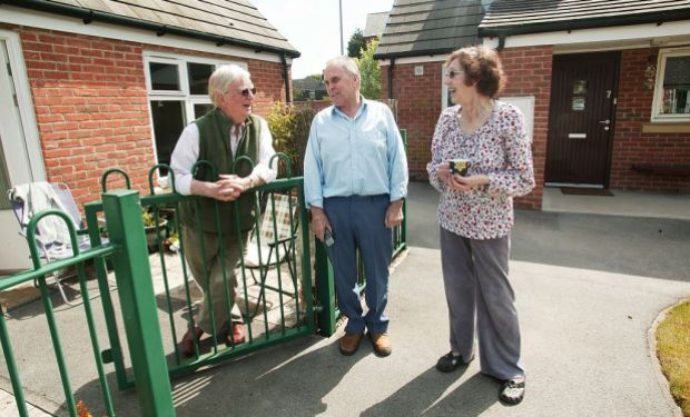Residents talking in a garden at Bedford Court