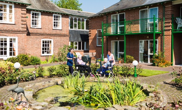 Residents enjoy the sun outside Lamel Beeches care home