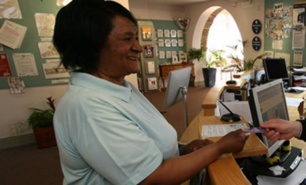 Resident paying their rent at a customer service desk