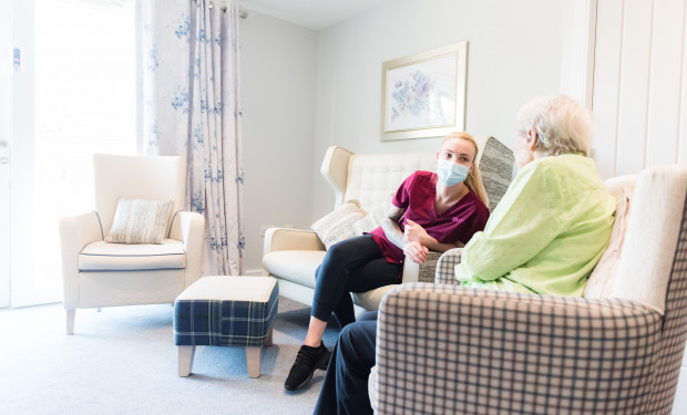 Resident with member of care team at New Lodge