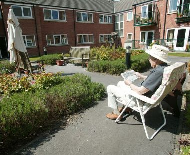 Elderly man enjoying the sun outside at Bedford Court