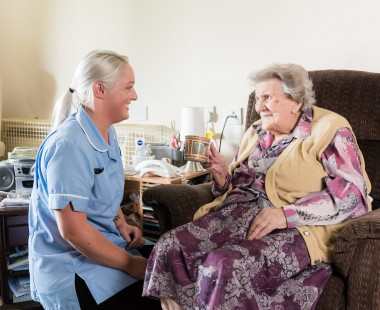 Resident and a member of staff talking