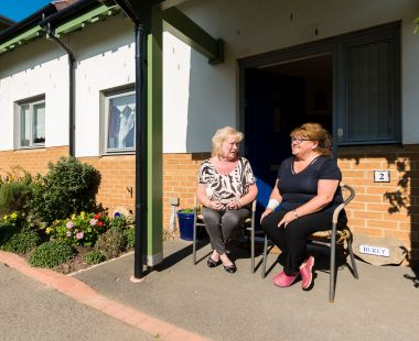 Residents sat outside a property